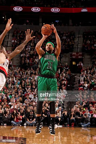 Jerryd Bayless of the Boston Celtics shoots against the Portland Trail Blazers on January 11 2014 at the Moda Center Arena in Portland Oregon NOTE TO...