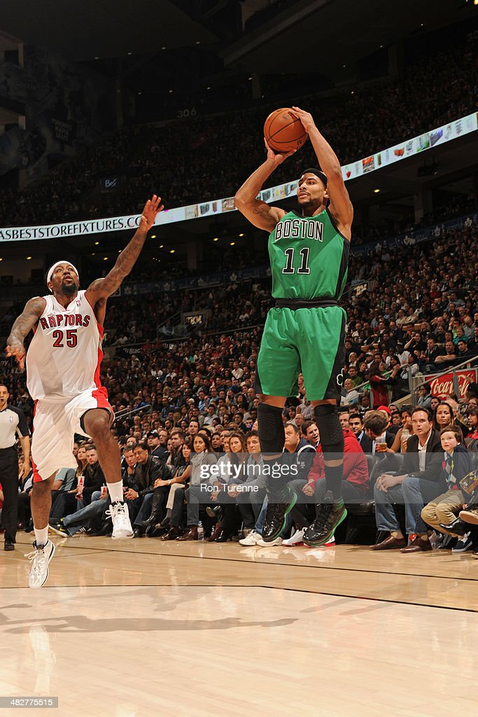 <a gi-track='captionPersonalityLinkClicked' href=/galleries/search?phrase=Jerryd+Bayless&family=editorial&specificpeople=4216027 ng-click='$event.stopPropagation()'>Jerryd Bayless</a> #11 of the Boston Celtics shoots against the Toronto Raptors on March 28, 2014 at the Air Canada Centre in Toronto, Ontario, Canada.