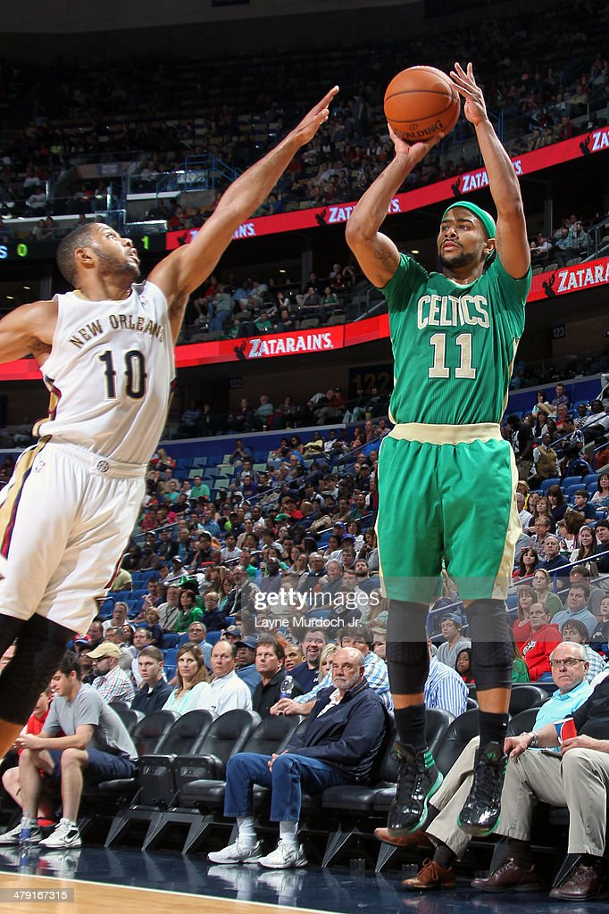 <a gi-track='captionPersonalityLinkClicked' href=/galleries/search?phrase=Jerryd+Bayless&family=editorial&specificpeople=4216027 ng-click='$event.stopPropagation()'>Jerryd Bayless</a> #11 of the Boston Celtics shoots the ball against the New Orleans Pelicans during an NBA game on March 16, 2014 at the Smoothie King Center in New Orleans, Louisiana.