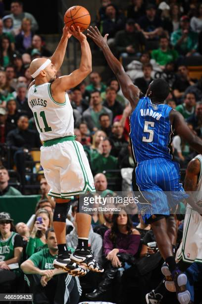 Jerryd Bayless of the Boston Celtics shoots the ball against Victor Oladipo of the Orlando Magic on February 2 2014 at the TD Garden in Boston...