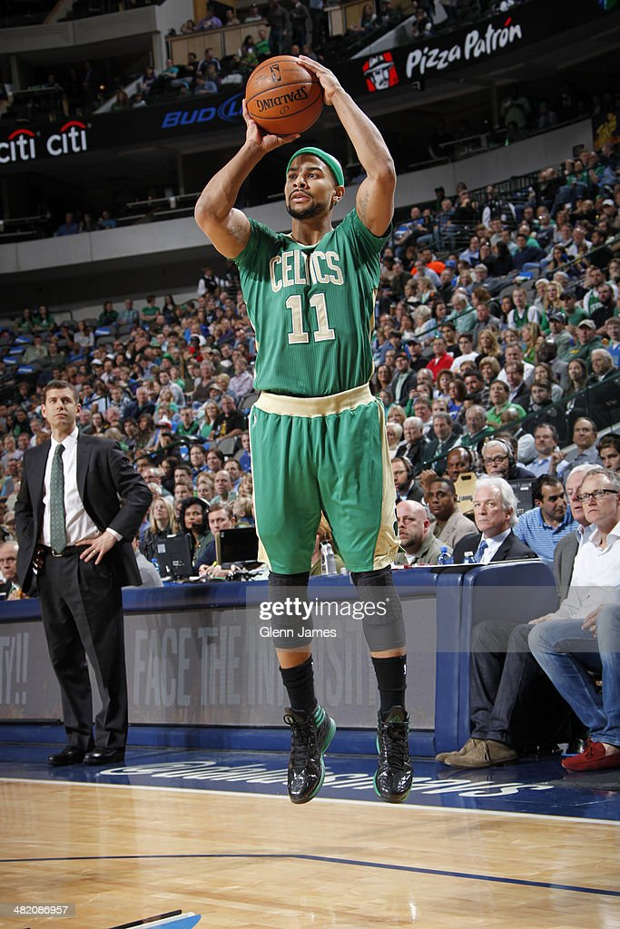 <a gi-track='captionPersonalityLinkClicked' href=/galleries/search?phrase=Jerryd+Bayless&family=editorial&specificpeople=4216027 ng-click='$event.stopPropagation()'>Jerryd Bayless</a> #11 of the Boston Celtics shoots the ball during the game against the Dallas Mavericks on March 17, 2014 at the American Airlines Center in Dallas, Texas.