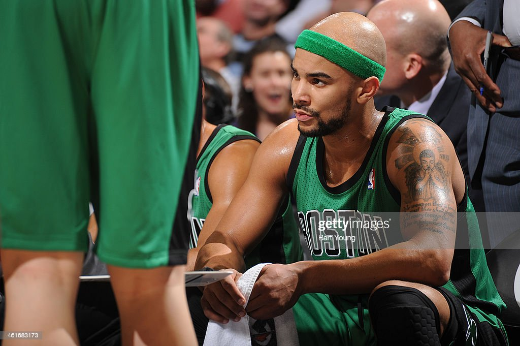 <a gi-track='captionPersonalityLinkClicked' href=/galleries/search?phrase=Jerryd+Bayless&family=editorial&specificpeople=4216027 ng-click='$event.stopPropagation()'>Jerryd Bayless</a> #11 of the Boston Celtics sits on the bench before the game against the Denver Nuggets on January 7, 2014 at the Pepsi Center in Denver, Colorado.