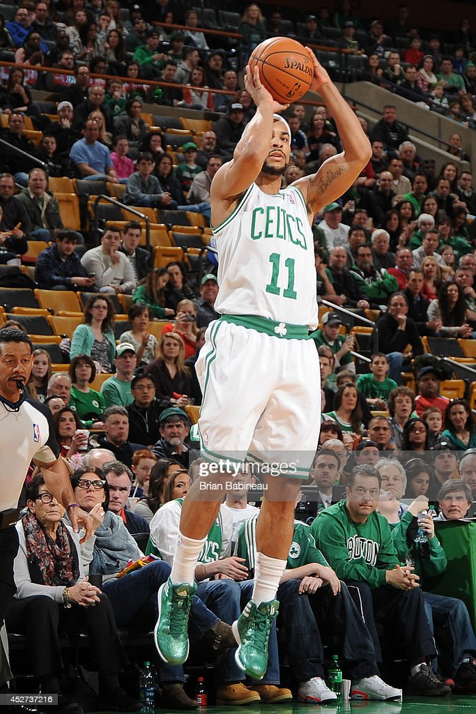 <a gi-track='captionPersonalityLinkClicked' href=/galleries/search?phrase=Jerryd+Bayless&family=editorial&specificpeople=4216027 ng-click='$event.stopPropagation()'>Jerryd Bayless</a> #11 of the Boston Celtics takes a shot against the Detroit Pistons on March 9, 2014 at the TD Garden in Boston, Massachusetts.