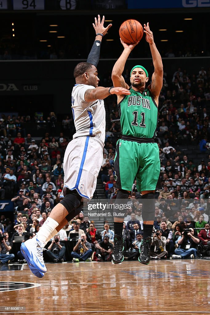 <a gi-track='captionPersonalityLinkClicked' href=/galleries/search?phrase=Jerryd+Bayless&family=editorial&specificpeople=4216027 ng-click='$event.stopPropagation()'>Jerryd Bayless</a> #11 of the Boston Celtics takes a shot against the Brooklyn Nets at the Barclays Center on March 21, 2014 in the Brooklyn borough of New York City.