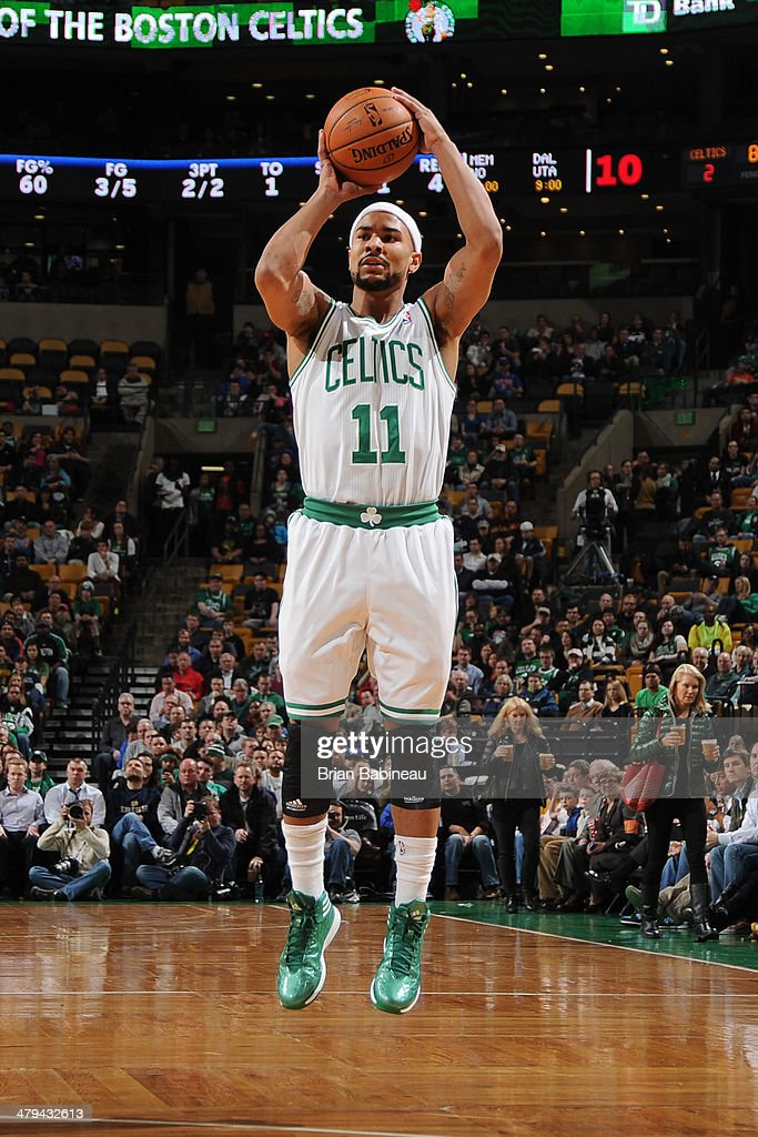 <a gi-track='captionPersonalityLinkClicked' href=/galleries/search?phrase=Jerryd+Bayless&family=editorial&specificpeople=4216027 ng-click='$event.stopPropagation()'>Jerryd Bayless</a> #11 of the Boston Celtics takes a shot against the New York Knicks on March 12, 2014 at the TD Garden in Boston, Massachusetts.