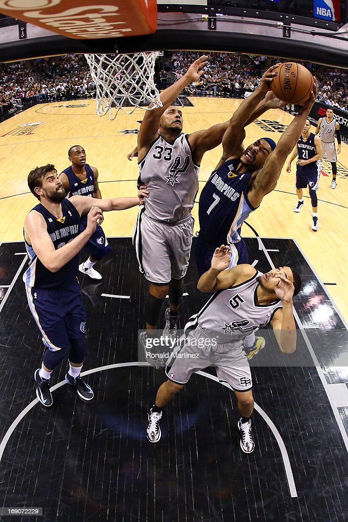 Jerryd Bayless #7 of the Memphis Grizzlies attempts a shot in the second half against Boris Diaw #33 and Cory Joseph #5 of the San Antonio Spurs during Game One of the Western Conference Finals of the 2013 NBA Playoffs at AT&T Center on May 19, 2013 in San Antonio, Texas.