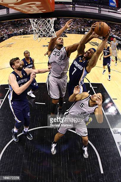 Jerryd Bayless of the Memphis Grizzlies attempts a shot in the second half against Boris Diaw and Cory Joseph of the San Antonio Spurs during Game...