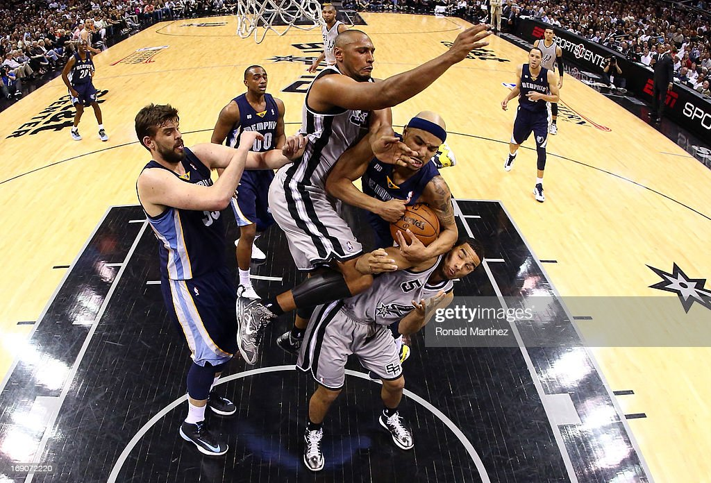 <a gi-track='captionPersonalityLinkClicked' href=/galleries/search?phrase=Jerryd+Bayless&family=editorial&specificpeople=4216027 ng-click='$event.stopPropagation()'>Jerryd Bayless</a> #7 of the Memphis Grizzlies draws contact as he drives to the basket in the second half against <a gi-track='captionPersonalityLinkClicked' href=/galleries/search?phrase=Boris+Diaw&family=editorial&specificpeople=201505 ng-click='$event.stopPropagation()'>Boris Diaw</a> #33 and <a gi-track='captionPersonalityLinkClicked' href=/galleries/search?phrase=Cory+Joseph&family=editorial&specificpeople=5953537 ng-click='$event.stopPropagation()'>Cory Joseph</a> #5 of the San Antonio Spurs during Game One of the Western Conference Finals of the 2013 NBA Playoffs at AT&T Center on May 19, 2013 in San Antonio, Texas.