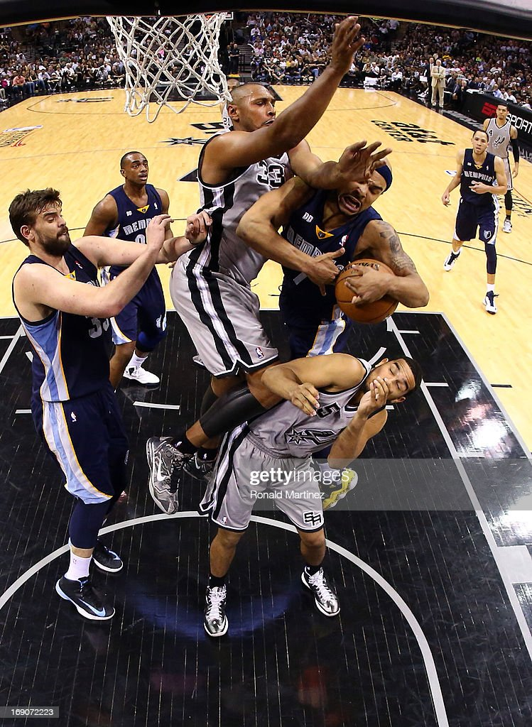 Jerryd Bayless #7 of the Memphis Grizzlies draws contact as he drives to the basket in the second half against Boris Diaw #33 and Cory Joseph #5 of the San Antonio Spurs during Game One of the Western Conference Finals of the 2013 NBA Playoffs at AT&T Center on May 19, 2013 in San Antonio, Texas.