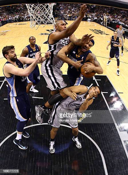 Jerryd Bayless of the Memphis Grizzlies draws contact as he drives to the basket in the second half against Boris Diaw and Cory Joseph of the San...