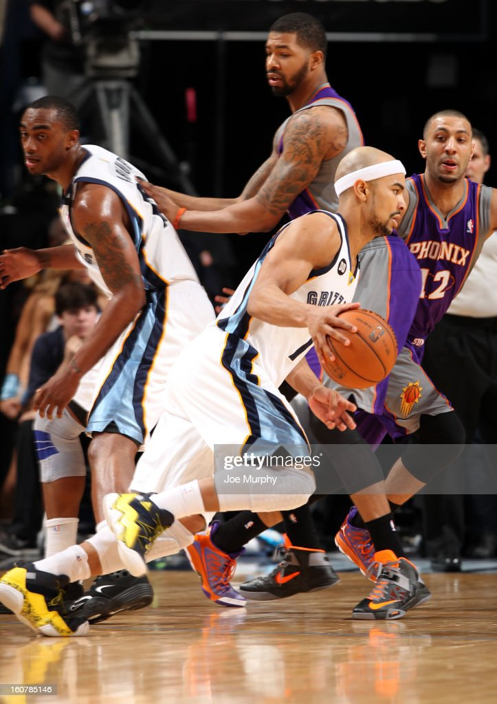 Jerryd Bayless #7 of the Memphis Grizzlies dribbles against Kendall Marshall #12 of the Phoenix Suns on February 5, 2013 at FedExForum in Memphis, Tennessee.