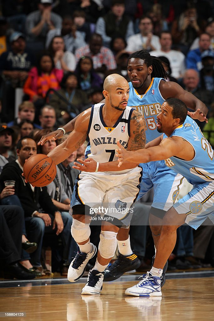 Jerryd Bayless #7 of the Memphis Grizzlies drives against Kenneth Faried #35 and Andre Miller #24 of the Denver Nuggets on December 29, 2012 at FedExForum in Memphis, Tennessee.
