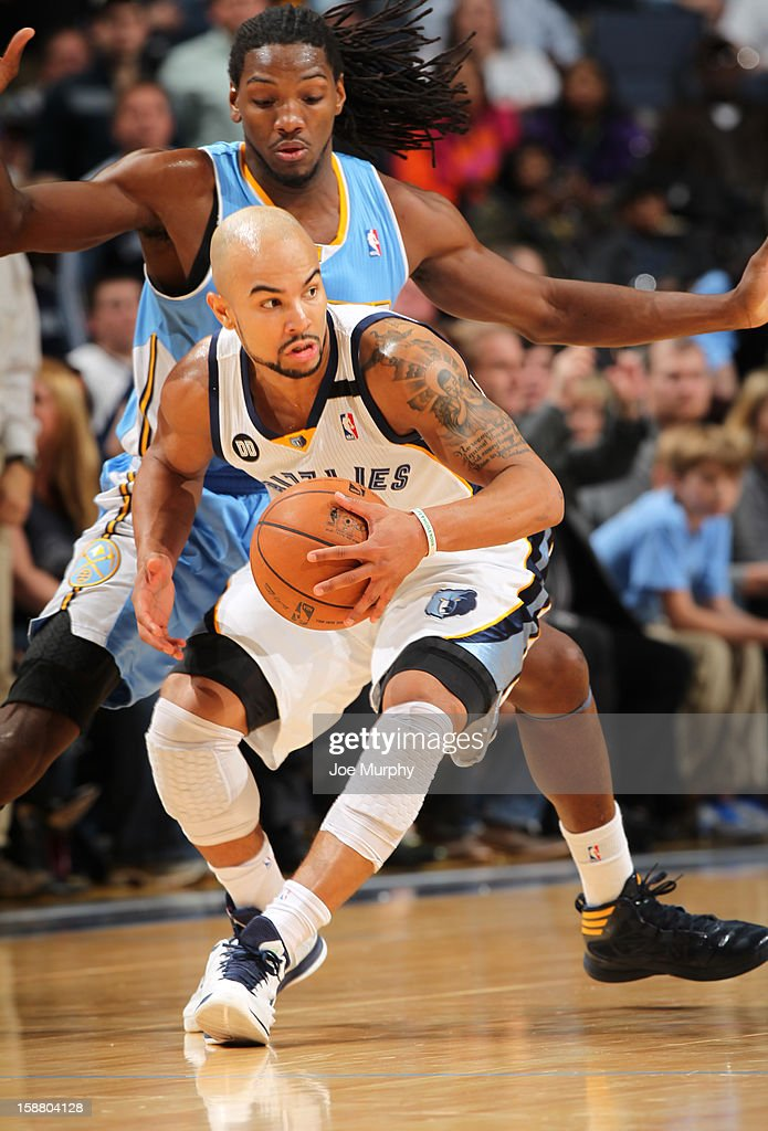 Jerryd Bayless #7 of the Memphis Grizzlies drives against Kenneth Faried #35 of the Denver Nuggets on December 29, 2012 at FedExForum in Memphis, Tennessee.