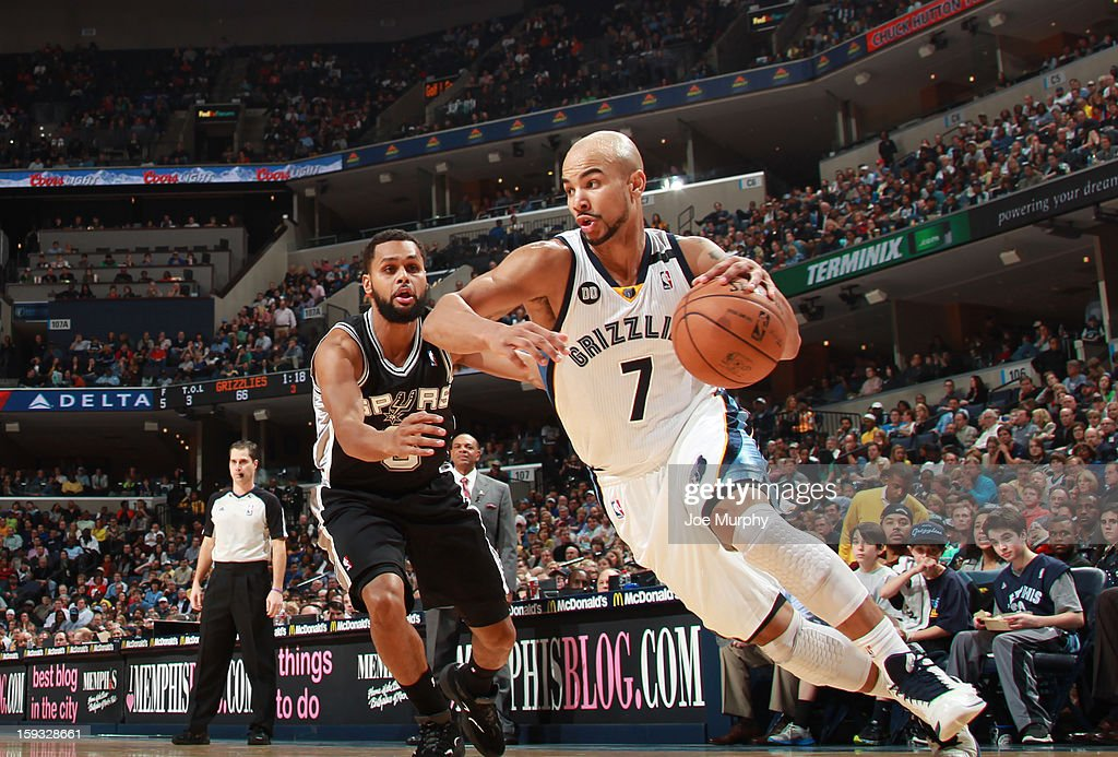Jerryd Bayless #7 of the Memphis Grizzlies drives against Patty Mills #8 of the San Antonio Spurs on January 11, 2013 at FedExForum in Memphis, Tennessee.