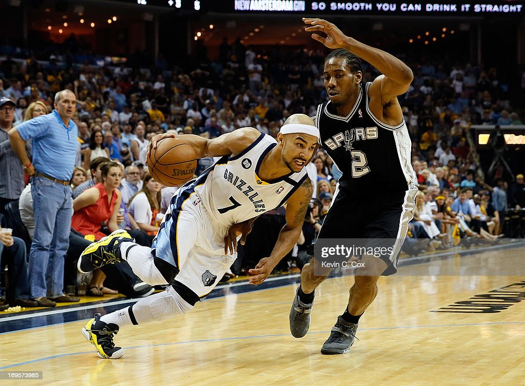 Jerryd Bayless #7 of the Memphis Grizzlies drives on Kawhi Leonard #2 of the San Antonio Spurs in the second half during Game Four of the Western Conference Finals of the 2013 NBA Playoffs at the FedExForum on May 27, 2013 in Memphis, Tennessee.