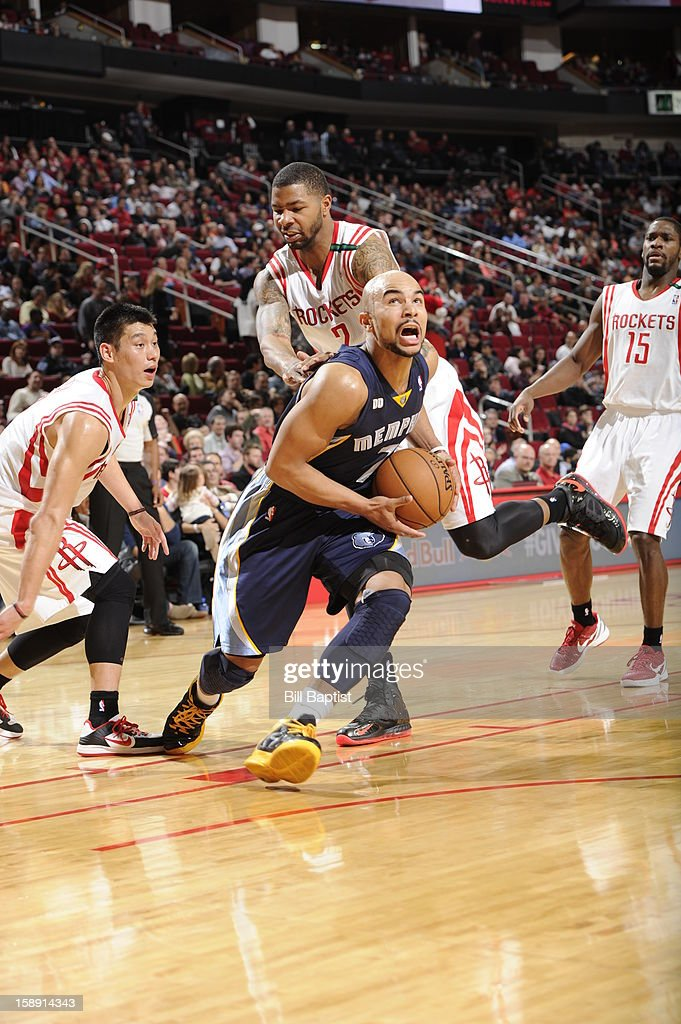 <a gi-track='captionPersonalityLinkClicked' href=/galleries/search?phrase=Jerryd+Bayless&family=editorial&specificpeople=4216027 ng-click='$event.stopPropagation()'>Jerryd Bayless</a> #7 of the Memphis Grizzlies drives to the basket against the Houston Rockets on December 22, 2012 at the Toyota Center in Houston, Texas.