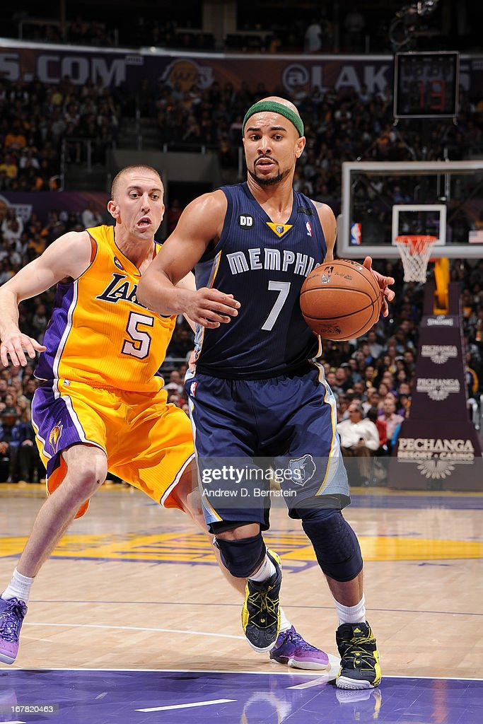 <a gi-track='captionPersonalityLinkClicked' href=/galleries/search?phrase=Jerryd+Bayless&family=editorial&specificpeople=4216027 ng-click='$event.stopPropagation()'>Jerryd Bayless</a> #7 of the Memphis Grizzlies drives to the basket against <a gi-track='captionPersonalityLinkClicked' href=/galleries/search?phrase=Steve+Blake+-+Basketball+Player&family=editorial&specificpeople=204474 ng-click='$event.stopPropagation()'>Steve Blake</a> #5 of the Los Angeles Lakers at Staples Center on April 5, 2013 in Los Angeles, California.