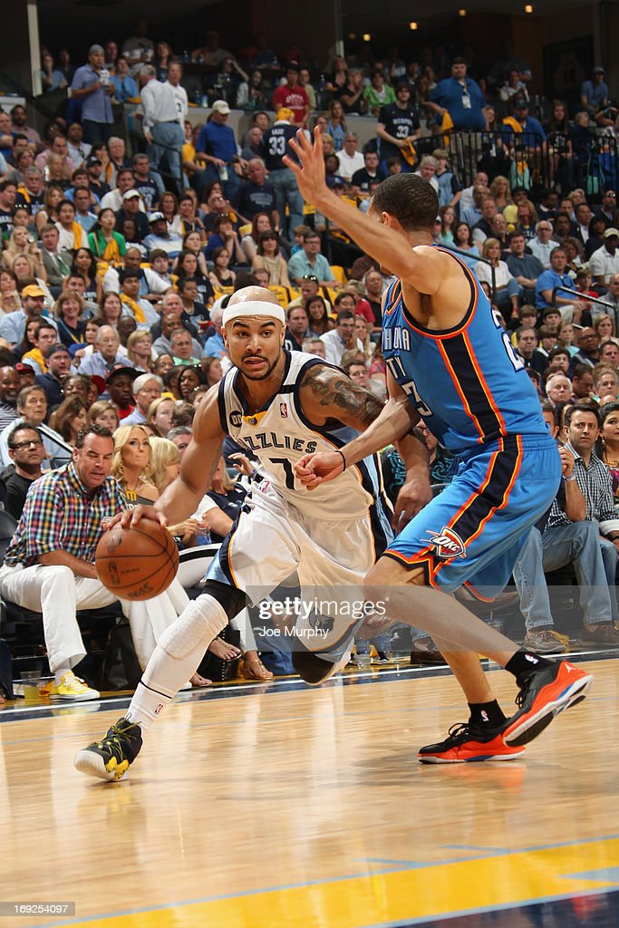 <a gi-track='captionPersonalityLinkClicked' href=/galleries/search?phrase=Jerryd+Bayless&family=editorial&specificpeople=4216027 ng-click='$event.stopPropagation()'>Jerryd Bayless</a> #7 of the Memphis Grizzlies drives to the basket against the Oklahoma City Thunder in Game Three of the Western Conference Semifinals during the 2013 NBA Playoffs on May 11, 2013 at FedExForum in Memphis, Tennessee.