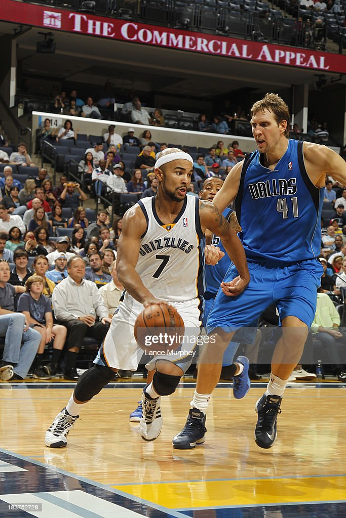 <a gi-track='captionPersonalityLinkClicked' href=/galleries/search?phrase=Jerryd+Bayless&family=editorial&specificpeople=4216027 ng-click='$event.stopPropagation()'>Jerryd Bayless</a> #7 of the Memphis Grizzlies drives to the basket against <a gi-track='captionPersonalityLinkClicked' href=/galleries/search?phrase=Dirk+Nowitzki&family=editorial&specificpeople=201490 ng-click='$event.stopPropagation()'>Dirk Nowitzki</a> #41 of the Dallas Mavericks during a game on October 9, 2013 at FedExForum in Memphis, Tennessee.