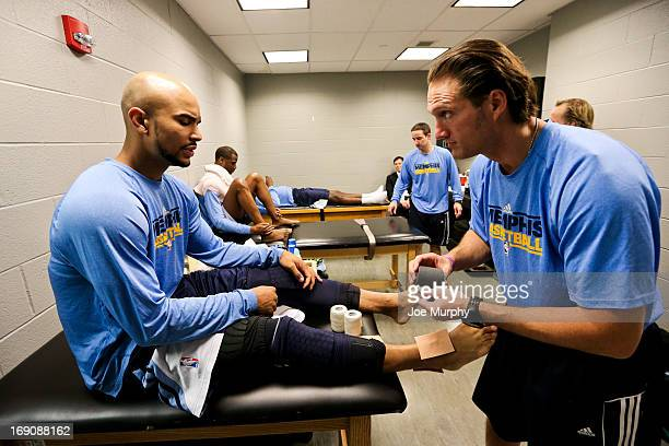 Jerryd Bayless of the Memphis Grizzlies gets taped up in the locker room before playing against the San Antonio Spurs in Game One of the Western...