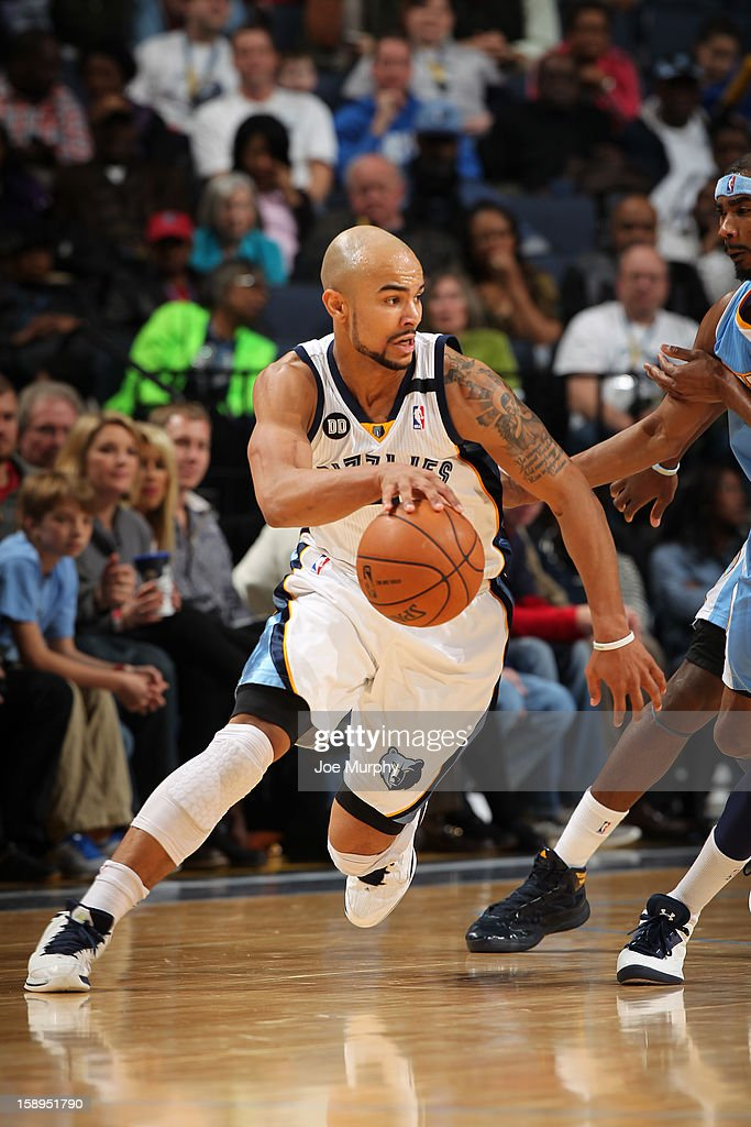 <a gi-track='captionPersonalityLinkClicked' href=/galleries/search?phrase=Jerryd+Bayless&family=editorial&specificpeople=4216027 ng-click='$event.stopPropagation()'>Jerryd Bayless</a> #7 of the Memphis Grizzlies handles the ball against the Denver Nuggets on December 29, 2012 at FedExForum in Memphis, Tennessee.