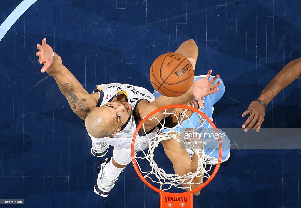 <a gi-track='captionPersonalityLinkClicked' href=/galleries/search?phrase=Jerryd+Bayless&family=editorial&specificpeople=4216027 ng-click='$event.stopPropagation()'>Jerryd Bayless</a> #7 of the Memphis Grizzlies rebounds against <a gi-track='captionPersonalityLinkClicked' href=/galleries/search?phrase=Andre+Miller&family=editorial&specificpeople=201678 ng-click='$event.stopPropagation()'>Andre Miller</a> #24 of the Denver Nuggets on November 19, 2012 at FedExForum in Memphis, Tennessee.