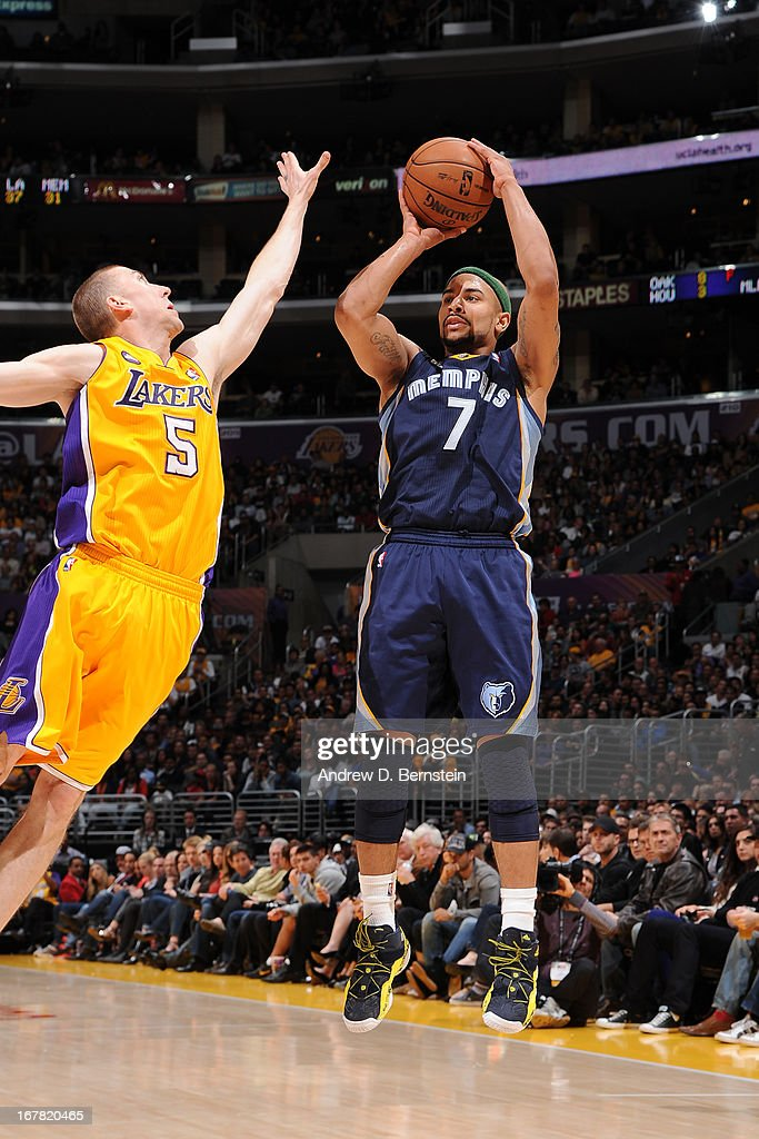 <a gi-track='captionPersonalityLinkClicked' href=/galleries/search?phrase=Jerryd+Bayless&family=editorial&specificpeople=4216027 ng-click='$event.stopPropagation()'>Jerryd Bayless</a> #7 of the Memphis Grizzlies shoots a jumper against <a gi-track='captionPersonalityLinkClicked' href=/galleries/search?phrase=Steve+Blake+-+Basketball+Player&family=editorial&specificpeople=204474 ng-click='$event.stopPropagation()'>Steve Blake</a> #5 of the Los Angeles Lakers at Staples Center on April 5, 2013 in Los Angeles, California.