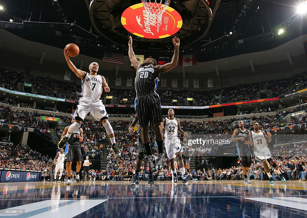 <a gi-track='captionPersonalityLinkClicked' href=/galleries/search?phrase=Jerryd+Bayless&family=editorial&specificpeople=4216027 ng-click='$event.stopPropagation()'>Jerryd Bayless</a> #7 of the Memphis Grizzlies shoots against <a gi-track='captionPersonalityLinkClicked' href=/galleries/search?phrase=DeQuan+Jones&family=editorial&specificpeople=5626127 ng-click='$event.stopPropagation()'>DeQuan Jones</a> #20 of the Orlando Magic on February 22, 2013 at FedExForum in Memphis, Tennessee.