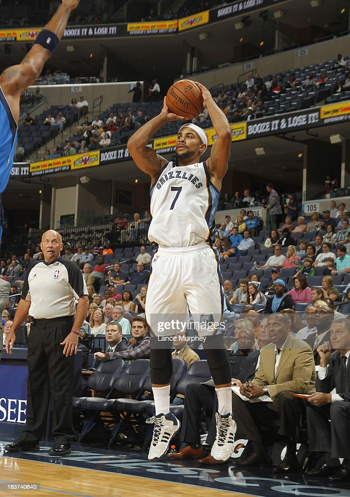 <a gi-track='captionPersonalityLinkClicked' href=/galleries/search?phrase=Jerryd+Bayless&family=editorial&specificpeople=4216027 ng-click='$event.stopPropagation()'>Jerryd Bayless</a> #7 of the Memphis Grizzlies shoots against the Dallas Mavericks during a game on October 9, 2013 at FedExForum in Memphis, Tennessee.