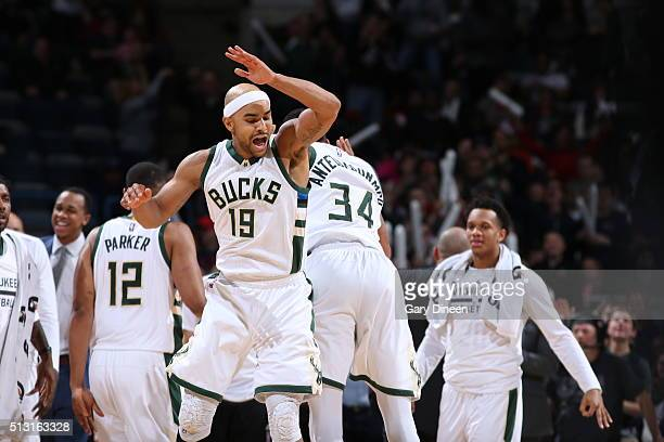 Jerryd Bayless of the Milwaukee Bucks celebrates with Giannis Antetokounmpo of the Milwaukee Bucks during the game against the Houston Rockets on...