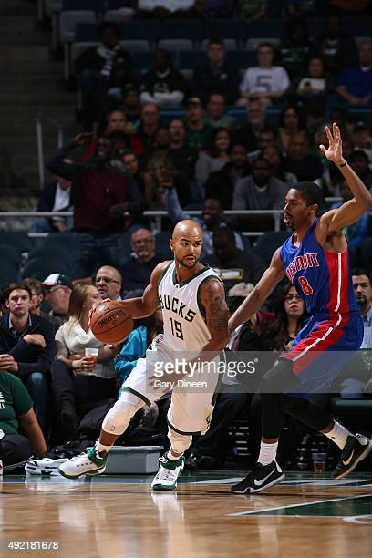 Jerryd Bayless of the Milwaukee Bucks handles the ball against Spencer Dinwiddie of the Detroit Pistons on October 10 2015 at the BMO Harris Bradley...