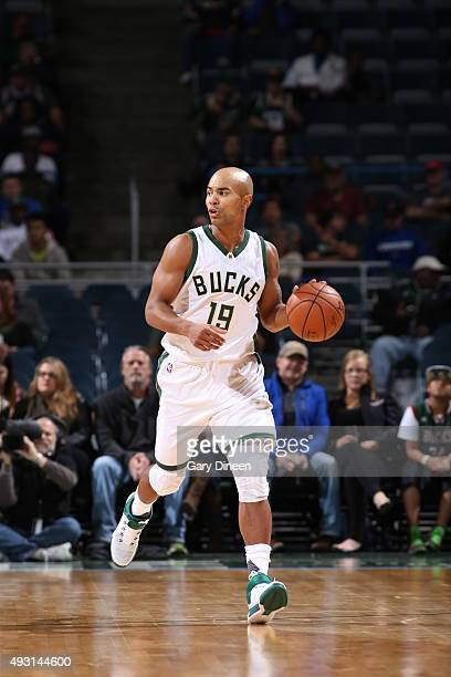 Jerryd Bayless of the Milwaukee Bucks handles the ball against the Washington Wizards during a preseason game on October 17 2015 at the BMO Harris...