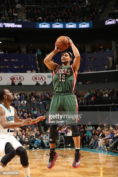 Jerryd Bayless of the Milwaukee Bucks shoots against the Charlotte Hornets during the game at the Time Warner Cable Arena on December 29 2014 in...