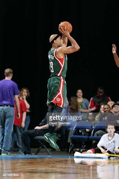 Jerryd Bayless of the Milwaukee Bucks shoots against the Minnesota Timberwolves on October 17 2014 at US Cellular Center in Cedar Rapids Iowa NOTE TO...