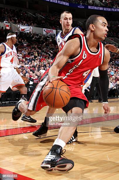 Jerryd Bayless of the Portland Trail Blazers drives to the basket against Sergio Rodriguez of the New York Knicks during the game at The Rose Garden...