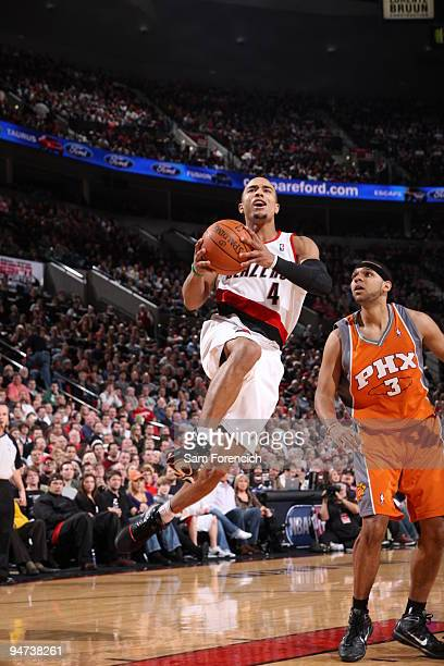 Jerryd Bayless of the Portland Trail Blazers goes up for a shot past Jared Dudley of the Phoenix Suns during a game on December 17 2009 at the Rose...