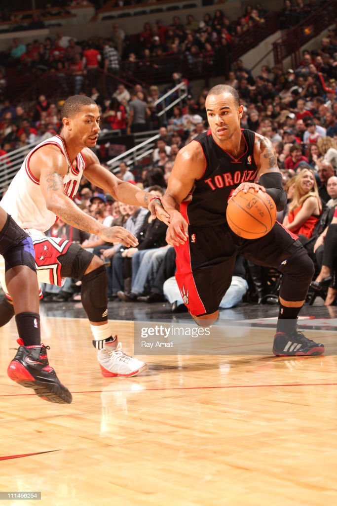 <a gi-track='captionPersonalityLinkClicked' href=/galleries/search?phrase=Jerryd+Bayless&family=editorial&specificpeople=4216027 ng-click='$event.stopPropagation()'>Jerryd Bayless</a> #5 of the Toronto Raptors drives against <a gi-track='captionPersonalityLinkClicked' href=/galleries/search?phrase=Derrick+Rose&family=editorial&specificpeople=4212732 ng-click='$event.stopPropagation()'>Derrick Rose</a> #1 of the Chicago Bulls on April 2, 2011 at the United Center in Chicago, Illinois.