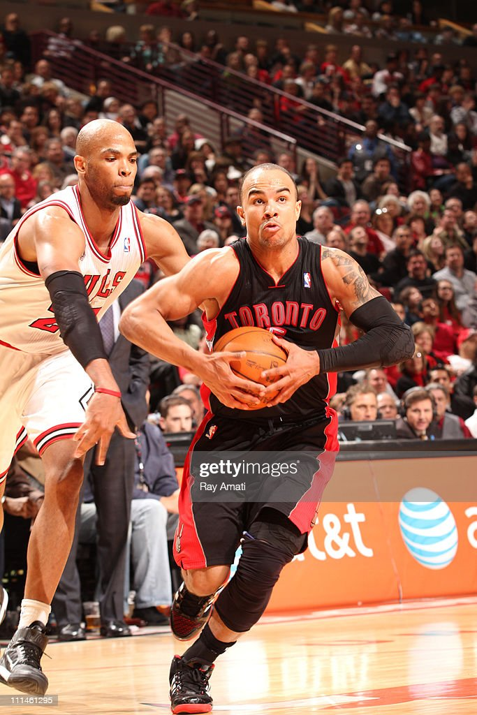 <a gi-track='captionPersonalityLinkClicked' href=/galleries/search?phrase=Jerryd+Bayless&family=editorial&specificpeople=4216027 ng-click='$event.stopPropagation()'>Jerryd Bayless</a> #5 of the Toronto Raptors in action against <a gi-track='captionPersonalityLinkClicked' href=/galleries/search?phrase=Taj+Gibson&family=editorial&specificpeople=4029461 ng-click='$event.stopPropagation()'>Taj Gibson</a> #22 of the Chicago Bulls on April 2, 2011 at the United Center in Chicago, Illinois.