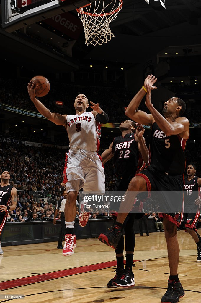 <a gi-track='captionPersonalityLinkClicked' href=/galleries/search?phrase=Jerryd+Bayless&family=editorial&specificpeople=4216027 ng-click='$event.stopPropagation()'>Jerryd Bayless</a> #5 of the Toronto Raptors shoots against the Miami Heat during a game on April 13, 2011 at the Air Canada Centre in Toronto, Ontario, Canada.