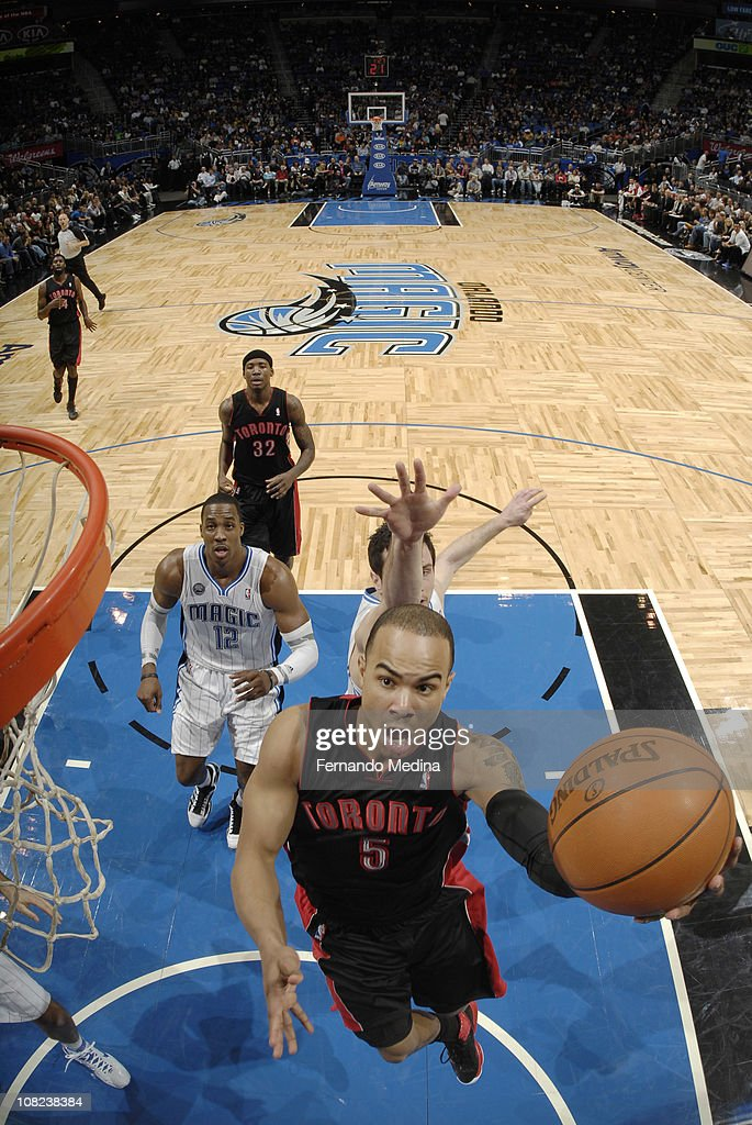 <a gi-track='captionPersonalityLinkClicked' href=/galleries/search?phrase=Jerryd+Bayless&family=editorial&specificpeople=4216027 ng-click='$event.stopPropagation()'>Jerryd Bayless</a> #5 of the Toronto Raptors shoots against the Orlando Magic on January 21, 2011 at the Amway Center in Orlando, Florida.