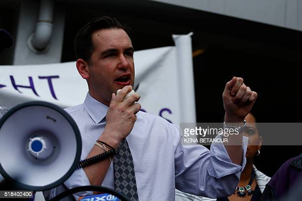 Jersey City Mayor Steven Fulop speaks during a rally organized by the workers union 32BJ SEIU in support of a strike of Newark Airport workers to...