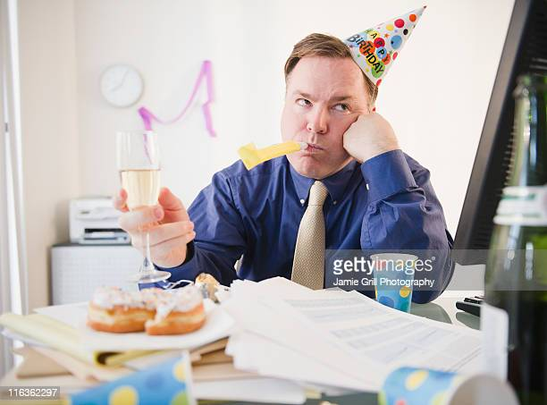 USA, Jersey City, New Jersey, businessman at office party