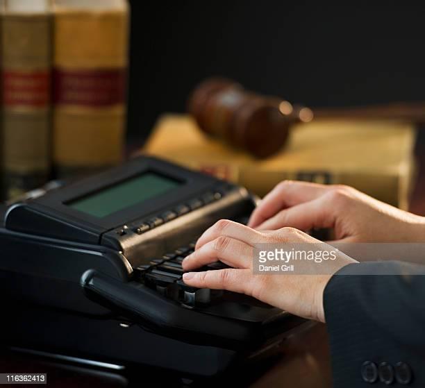 USA, Jersey City, New Jersey, court stenographer using stenograph machine