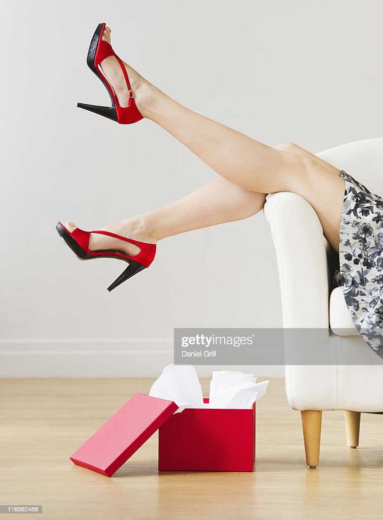 USA, Jersey City, New Jersey, low section of woman swinging legs with new shoes on