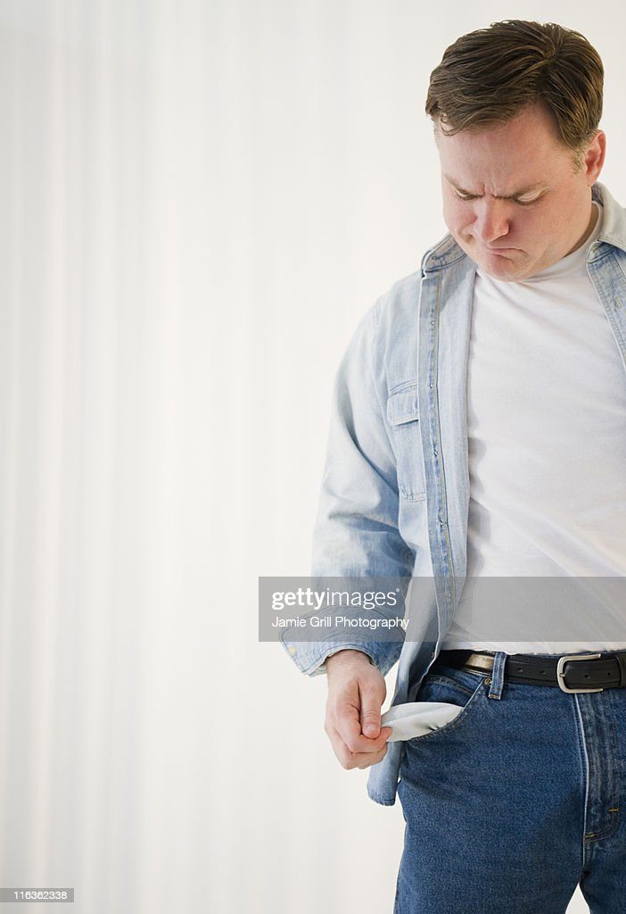 USA, Jersey City, New Jersey, man emptying pockets