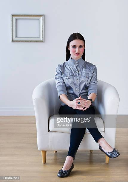 USA, Jersey City, New Jersey, portrait of woman sitting in armchair