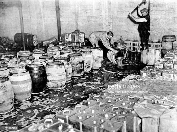 Jersey City police destroying confiscated barrels of beer during Prohibition