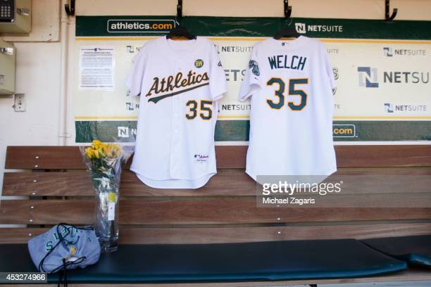 A jersey hangs in the dugout to honor former Oakland Athletic Bob Welch prior to a pregame ceremony honoring the Athletics 1989 World Series team...