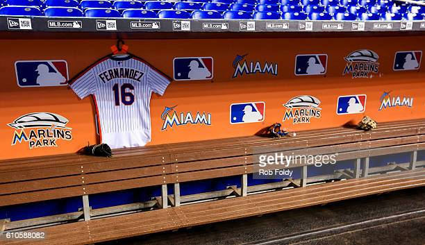 A jersey hangs in the New York Mets dugout in honor of late Miami Marlins pitcher Jose Fernandez before the game against the Miami Marlins at Marlins...