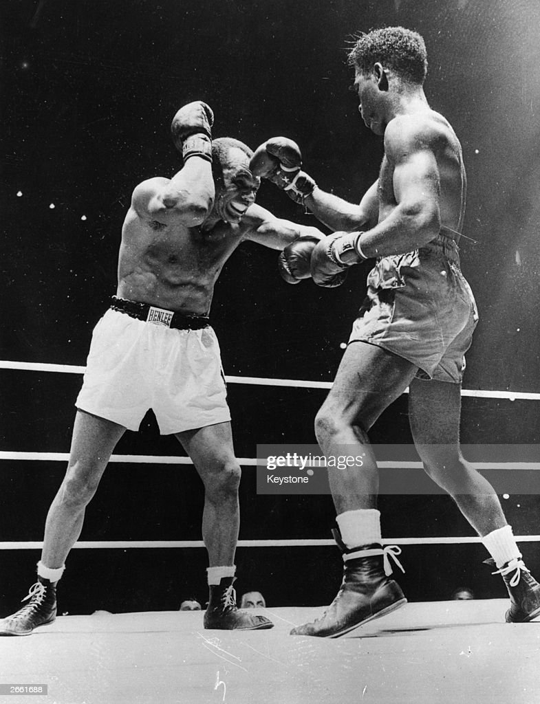 Jersey Joe Walcott grimaces in the last round of his heavyweight title fight with <a gi-track='captionPersonalityLinkClicked' href=/galleries/search?phrase=Ezzard+Charles&family=editorial&specificpeople=215068 ng-click='$event.stopPropagation()'>Ezzard Charles</a> in Chicago, Charles being awarded the contest by receiving 233 points to Walcott's 217.